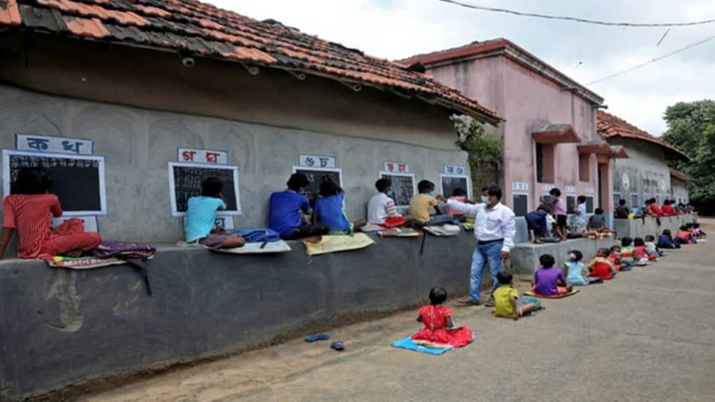 In remote village, teacher turns walls into blackboards