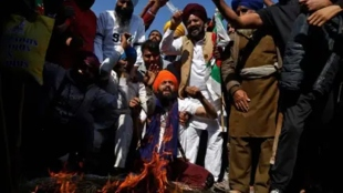 singhu protest site man tied to barricade arm chopped off and lynched Nihang Sikhs